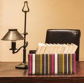 Boxed books with lamp — Stock Photo