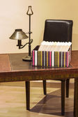 Boxed books on a desk — Stock Photo