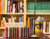 Boxed books with lamp and shelves — Stock Photo