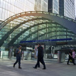 LONDON, UK - MARCH 10, 2014: Canary Wharf business aria with more than 100.000 working places. Tube entrance and early morning commuters — Stock Photo #42577197