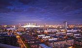 LONDON, UK - MARCH 05, 2014: view on O2 dome, millennium Dome, main arena for pop performances and show events. Residential site of local docks in front — Stock Photo