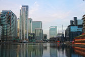 LONDON, UK - MARCH 06, 2014: view on Canary Wharf international business aria from  residential site of local docks. Popular place to live among office workers — Stock Photo
