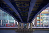 LONDON, UK - CANARY WHARF, MARCH 22, 2014: View from bottom of the bridge — Stock Photo