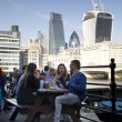 LONDON, UK - MARCH 29, 2014 South bank walk of the river Thames Young people in cafe — Stock Photo #43806439