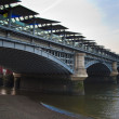 LONDON, UK - MARCH 29, 2014  South bank walk of the river Thames  View on bridges and modern architecture — Stock Photo #43809851