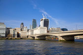 LONDON, UK - MARCH 29, 2014  South bank walk of the river Thames  View on bridges and modern architecture — Stock Photo