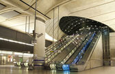 LONDON, CANARY WHARF UK - APRIL 4, 2014: Canary Wharf tube station, modern station bringing about 100 000 workers to the area every day — Stock Photo