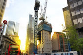 LONDON, UK - APRIL 24, 2014: Building site with cranes in the City of London one of the leading centres of global finance. — Stock Photo