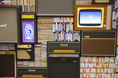 LONDON, UK - MAY 18, 2014  Decorative front panel, background made of old radio, TV, collection of dicks and video tapes — Stock Photo