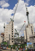 LONDON, UK - JULY 03, 2014: Big building site in the Bank of England aria. Erasing new office and apartment buildings — Stock Photo