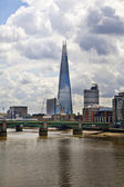 LONDON, UK - JUNE 30, 2014: Shard of glass on the river Thames, office and residential building in the City of London one of the leading centres of global finance. — 图库照片