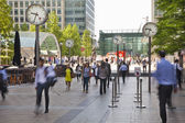LONDON, UK - JULY 03, 2014: People blur. Office people moving fast to get to work at early morning in Canary Wharf aria — Stockfoto