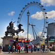 LONDON, UK - MAY 14, 2014: London eye is a giant Ferris wheel opened on 31 December 1999, the most famous tourist's attraction in center London — Stock Photo #49906631