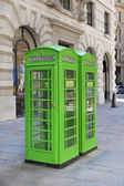 LONDON, UK - JULY 6, 2014: British red iconic phone box next to St. Paul's cathedral — Stock Photo
