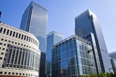 LONDON, CANARY WHARF UK - JULY 13, 2014: - Modern glass architecture of Canary Wharf business aria, headquarters for banks, insurance, media and other world known companies. — Stock Photo