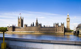 LONDON, UK - MAY 14, 2014: Big Ben and houses of Parliament on the river Thames, London UK — Stock Photo