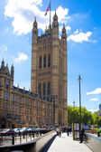 LONDON, UK - JULY 14, 2014: Big Ben and houses of Parliament on the river Thames, London UK — Stock Photo