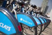 LONDON, UK - MAY 7, 2014: Boris bikes parking on business Canary Wharf aria, sponsored by Barkley's bank. Popular city transport among Londoners — Stock Photo