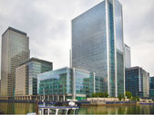 LONDON, UK - JULY 14, 2014: Modern glass architecture of Canary Wharf aria the leading centre of global finance, banking, media, insurance etc. Office buildings — Stock Photo