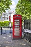 LONDON, UK - JUNE 24, 2014: Phone box in Westminster, red symbol of Great Britain — Stock Photo
