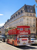 LONDON, UK - JULY 29, 2014: Regent street in London, tourists and buses — Stock Photo