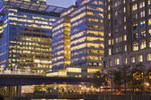 LONDON, UK - JULY 14, 2014: Canary Wharf at dusk, Famous skyscrapers of London's financial district at twilight. — Stock Photo