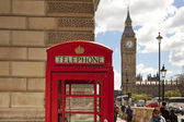 LONDON, UK - JUNE 24, 2014: Phone box in Westminster, red symbol of Great Britain — Stock Photo