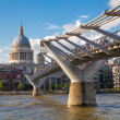 LONDON, UK - AUGUST 9, 2014: South bank walk of the river Thames. St. Paul's cathedral. View on bridge and modern architecture — Stock Photo #51432535