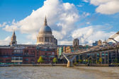 LONDON, UK - AUGUST 9, 2014: South bank walk of the river Thames. St. Paul's cathedral. View on bridge and modern architecture — Stock Photo