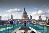 LONDON, UK - AUGUST 9, 2014: South bank walk of the river Thames. St. Paul's cathedral. View on bridge and modern architecture — Stok fotoğraf