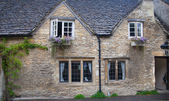 WILTSHIRE, CHIPPENHAM, UK - AUGUST 9, 2014: Castle Combe, unique old English village and luxury golf club — Stock Photo