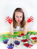 Girl drawing with water colours — Stock Photo