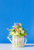 Flower and potted beautiful on wooden table background — Photo
