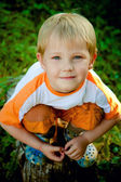 Boy squatting — Stock Photo