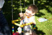 Little boy on a swing — Stock Photo