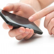 Close up of musing mobile smart phone — Stockfoto #37650849