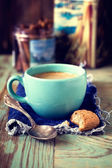 Blue cup coffe and biscuit — Stock Photo
