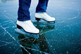 Young woman outdoor rink on a pond on a sunny day — Stock Photo