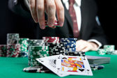 Card player gambling casino chips on green felt background selective focus — Stock Photo