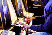 Men  Playing with Slot Machines — Stock Photo