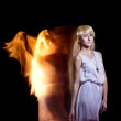 Behind the beautiful young girl with a fair hair the fiery angel — Stock Photo