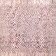 Burlap patch  on wooden background — Zdjęcie stockowe