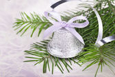 Christmas bell with fir-tree twigs — Stock Photo