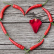 Heart made of Chili Pepper with rose-petal inside — Stockfoto