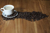 Coffee cup on the brown table — Stock Photo