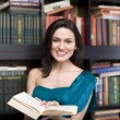 Stock photo portrait of beauty young woman reading book in library — Stock Photo #37416009