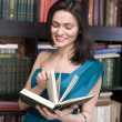 Stock photo portrait of beauty young woman reading book in library — Stock Photo #37416029