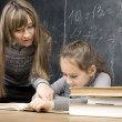 Stock Photo: Portrait of teacher with pupil at blackboard
