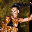 Stock Photo: Amazing shot of young beautiful brunette with her naked body covered of sweet cream chocolate
