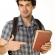 Stock Photo: Young happy student carrying bag and books